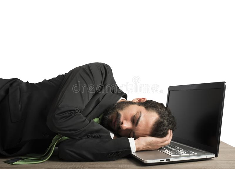 Workload businessman sleeping. Businessman workload falls asleep tired on computer royalty free stock images