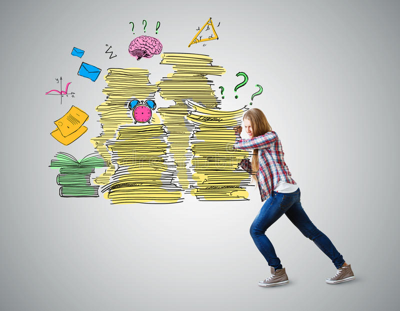 Workload concept. Casual european girl pushing drawn paper stacks on grey background. Workload concept stock image