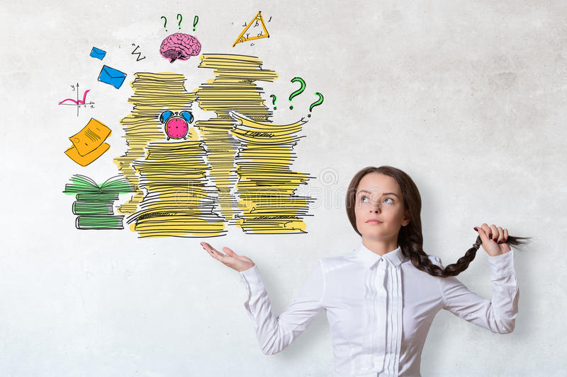 Workload concept. Pretty caucasian woman holding drawn paperwork pile on concrete background. Workload concept royalty free stock images