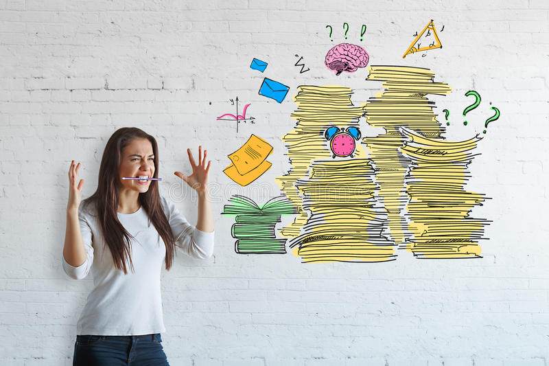 Workload concept. Stressed girl with a lot of work to do. Workload concept royalty free stock images
