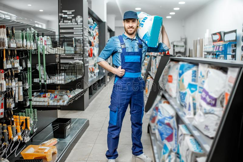 Workman buying building mixtures in the supermarket stock photo