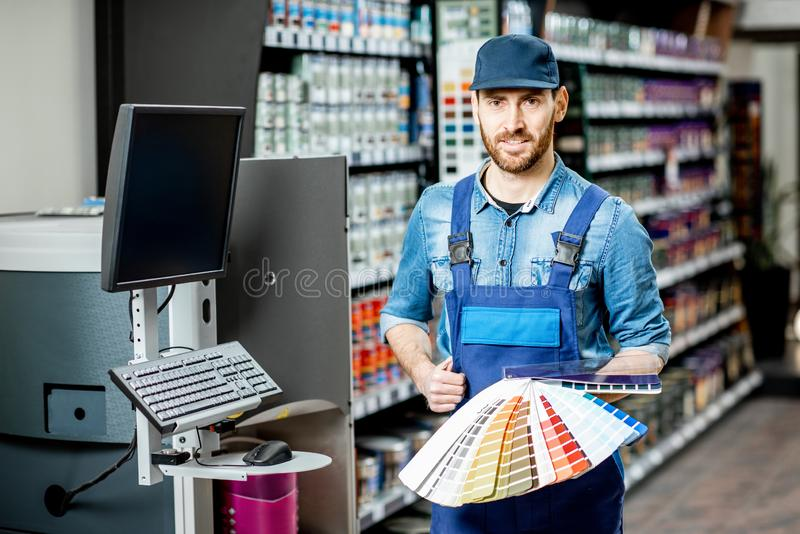 Workman with color swatches in the building shop stock images