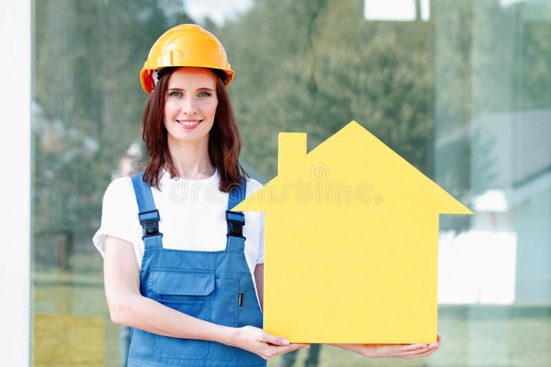 Workman and house symbol stock photos