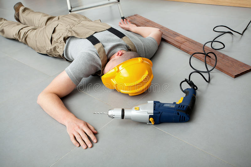 Workman injured at work stock images