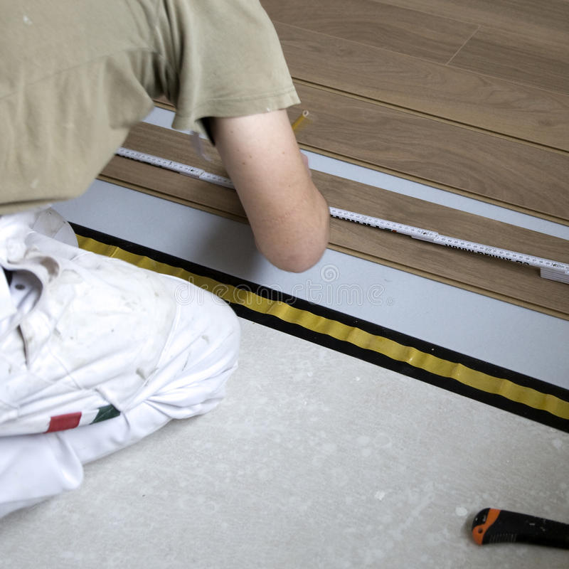 Download Workman laying flooring stock image. Image of laminate - 12883197