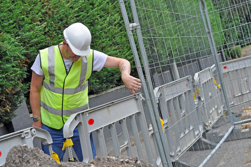 Download Workman Looking Down At Fence Stock Image - Image of energy, city: 36754265
