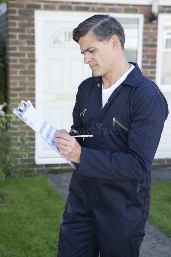 Free Workman Preparing Estimate For Work On House Exterior Stock Photo - 60397550