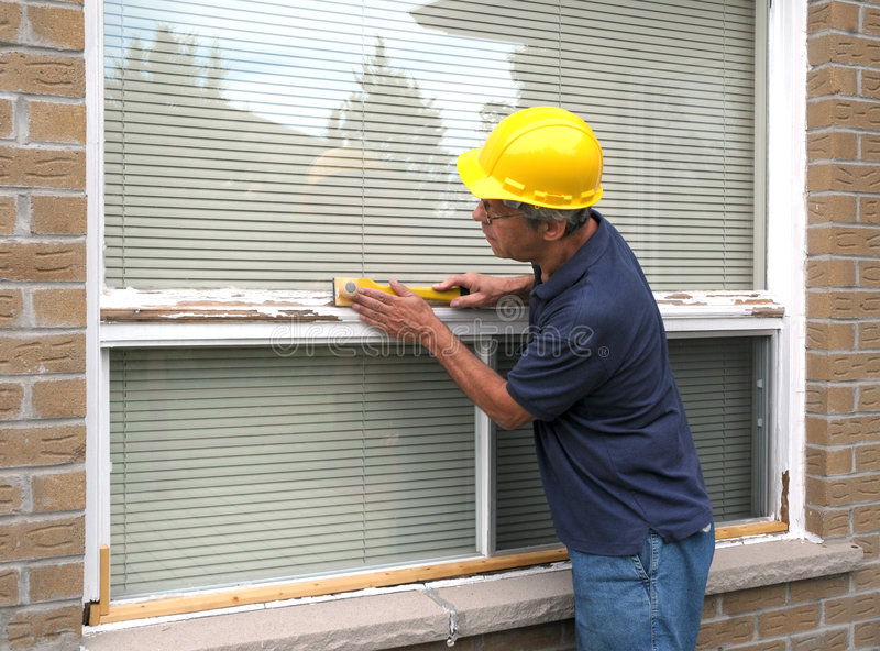 Download Workman repairing a window stock photo. Image of home - 6296478