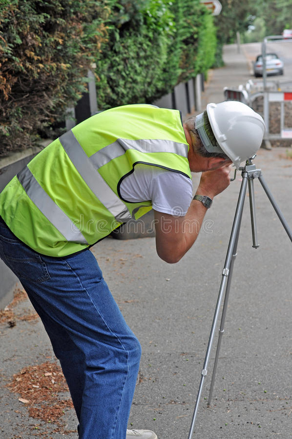 Download Workman surveying road stock photo. Image of hard, gravel - 36754438