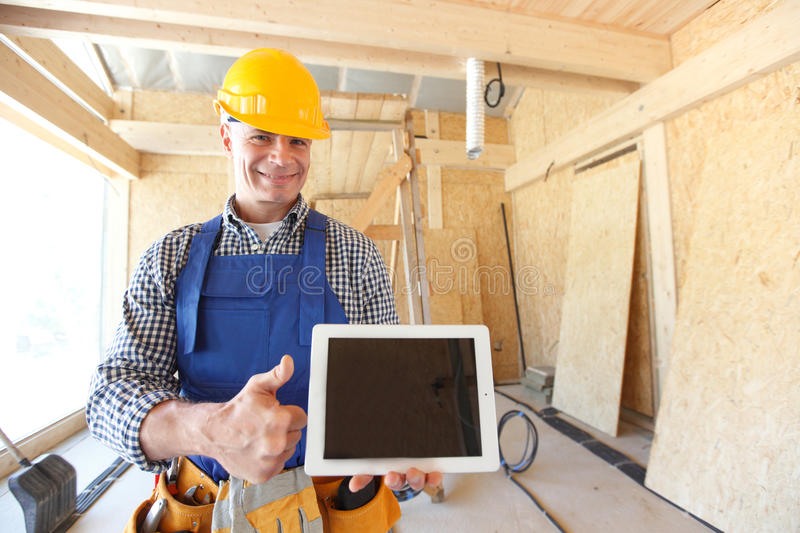 Workman with tablet stock images