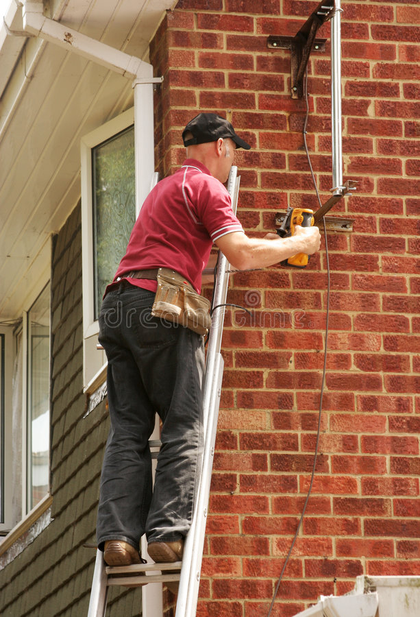 Workman up ladder royalty free stock images