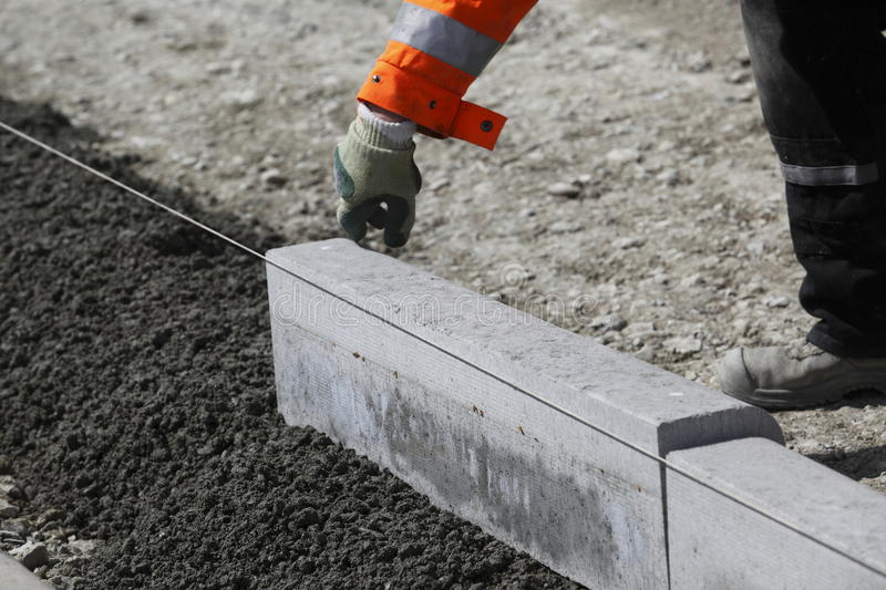 Workmen laying curbstones stock photography