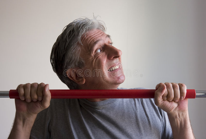 Workout 2. Fifty-year-old man training with difficulty stock photos