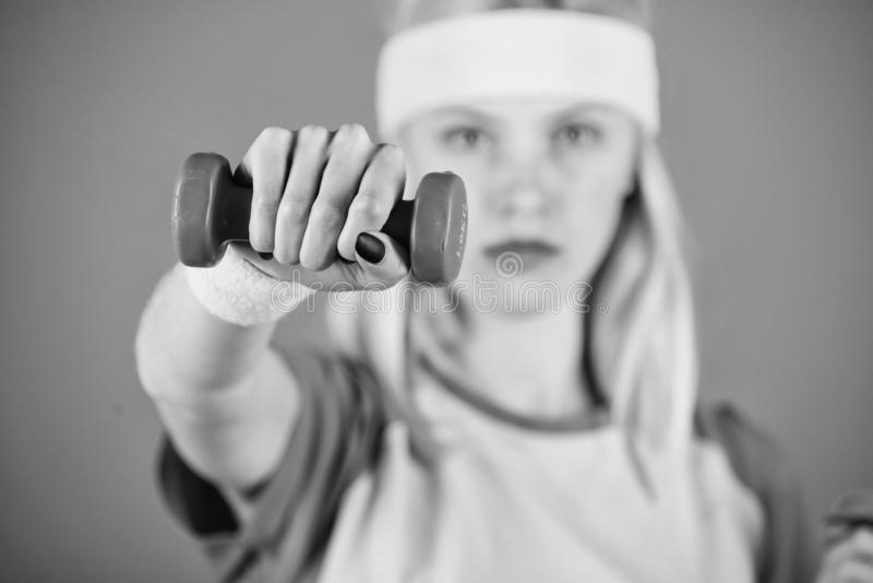 Workout with dumbbells. Biceps exercises for women step by step guide. Girl strong hold dumbbells wear wristbands. Sport. Workout with dumbbells. Biceps royalty free stock photo