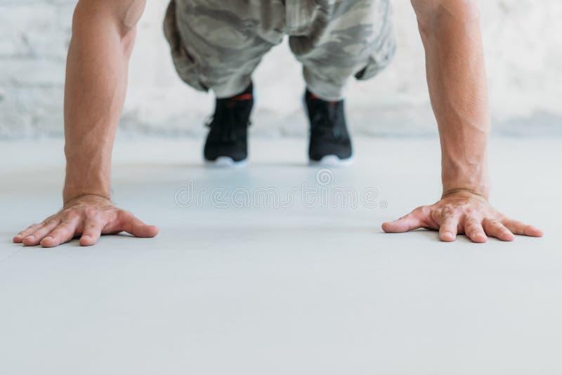 Workout exercise man push ups athletic lifestyle. Workout and exercise. man doing push ups. athletic lifestyle and training stock images