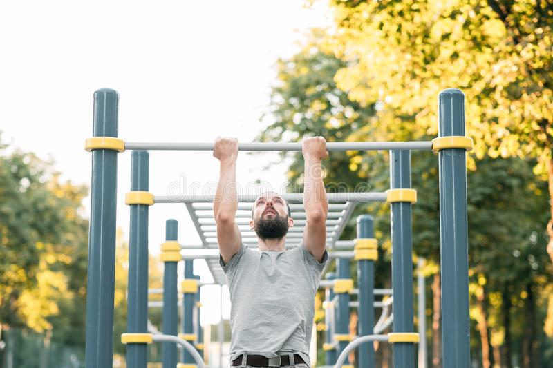 Workout exercise man pull ups athletic lifestyle. Workout and exercise. man doing pull ups. athletic lifestyle and training royalty free stock images