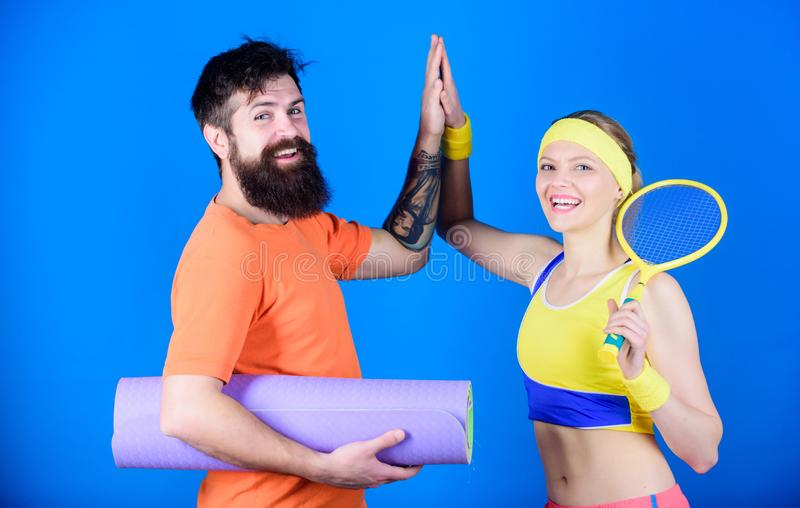 Workout and fitness. Girl and guy live healthy life. Fitness exercises. Sporty couple. Healthy lifestyle concept. Man. And women couple in love with yoga mat royalty free stock photo