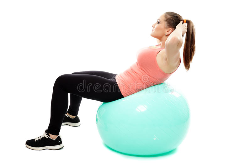 Workout with a gym ball. Young caucasian woman doing fitness workout with a gym ball royalty free stock photos