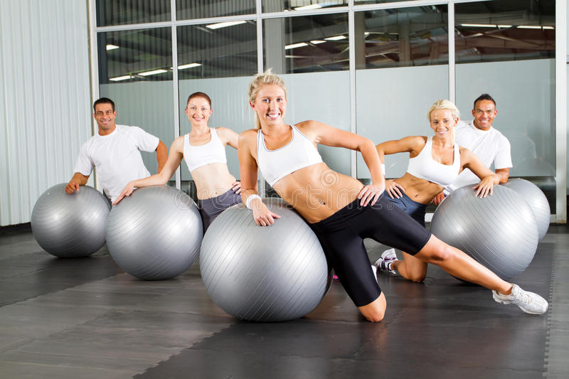 Workout with gymnastic ball. Group of people doing workout with gymnastic ball in a gym royalty free stock photography