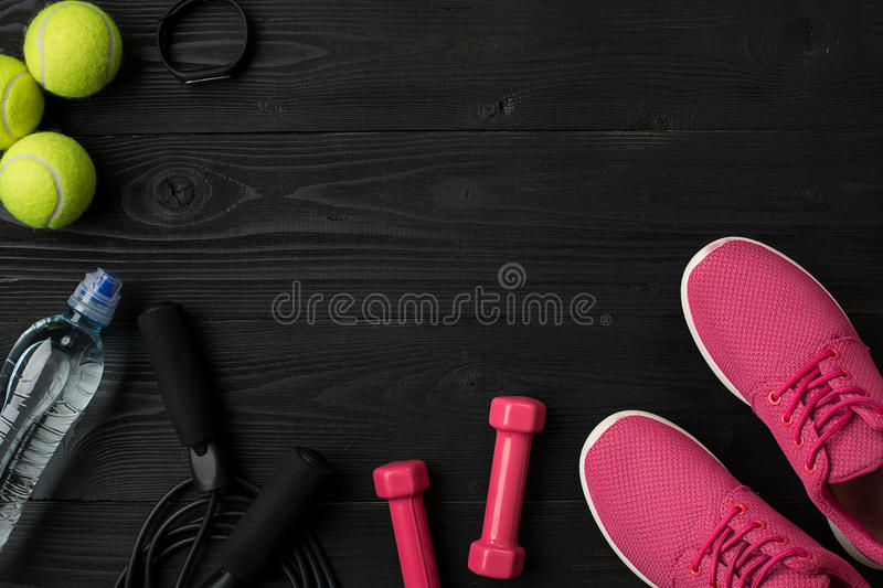 Workout plan with fitness food and equipment on dark background, top view. Copy space. Still life royalty free stock photo