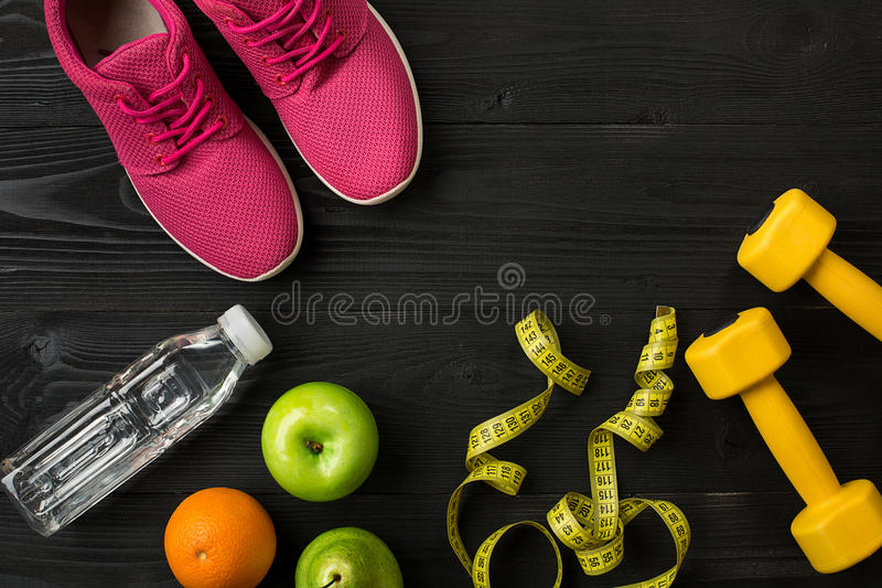 Workout plan with fitness food and equipment on dark background, top view. Copy space. Still life stock photography