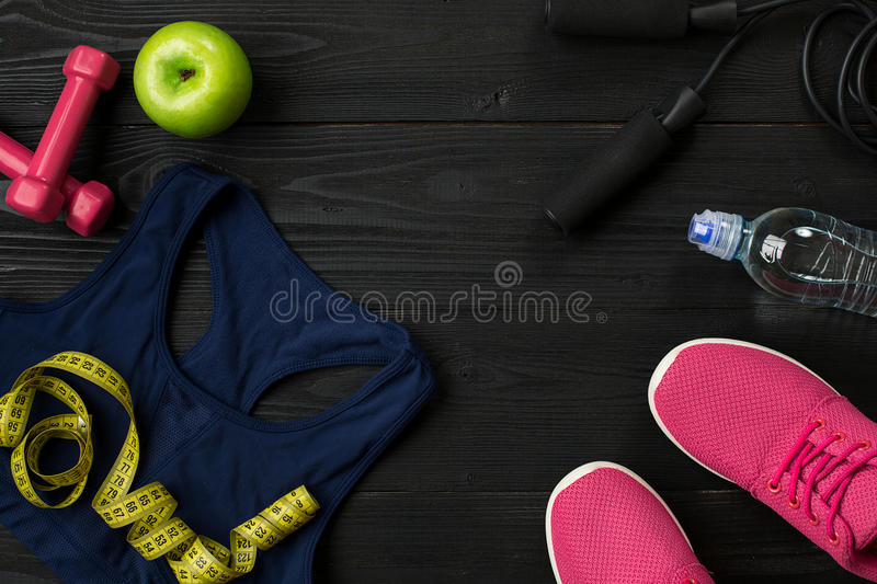 Workout plan with fitness food and equipment on dark background, top view. Workout plan with fitness food and sport equipment on dark background, top view. Copy stock photo