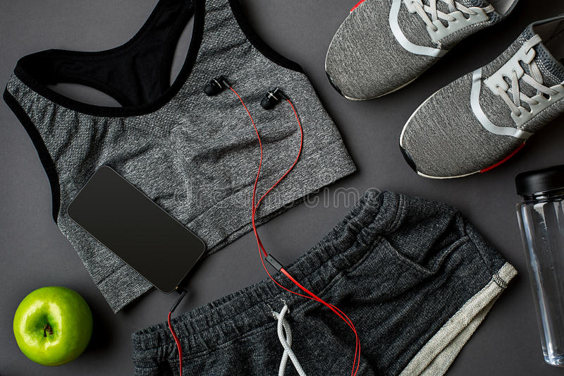 Workout plan with fitness food and equipment on gray background, top view. Workout plan with fitness food and sport equipment on gray background, top view. Copy royalty free stock image