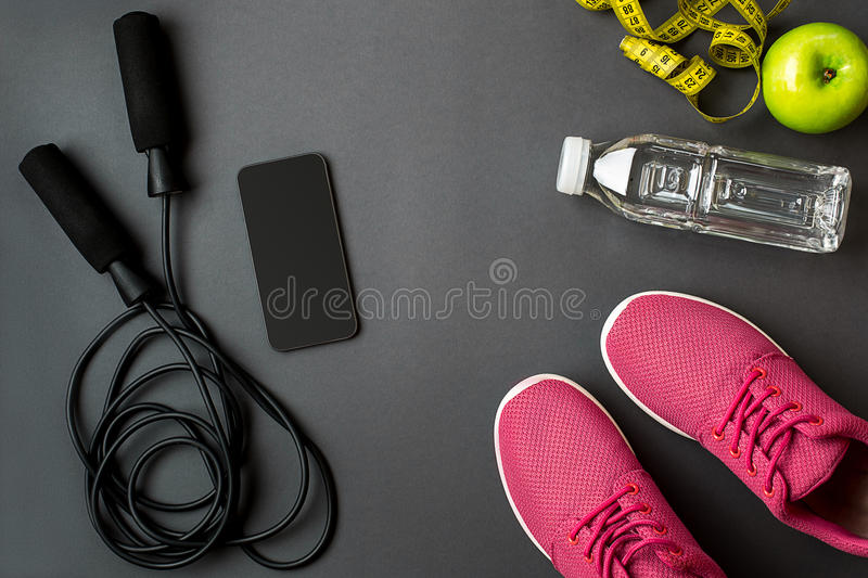 Workout plan with fitness food and equipment on gray background, top view. Workout plan with fitness food and sport equipment on gray background, top view. Copy stock photo