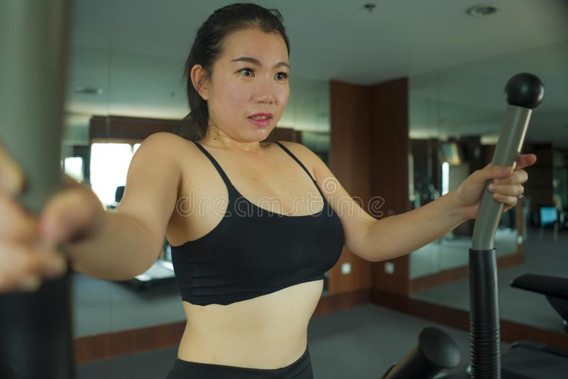 Portrait of young beautiful and attractive Asian Japanese woman training at hotel gym or fitness club working hard in cardio. Workout portrait of young beautiful royalty free stock images