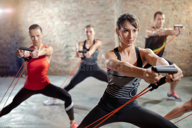 Workout with a resistance band. Group exercising with a resistance band royalty free stock photography