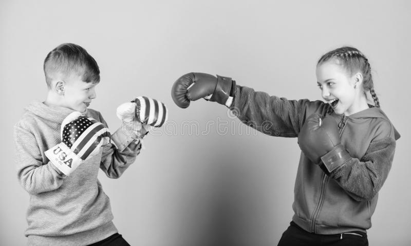 Workout of small girl and boy boxer in sportswear. Happy children in boxing gloves. Fitness diet. punching knockout. Childhood activity. Sport success royalty free stock images