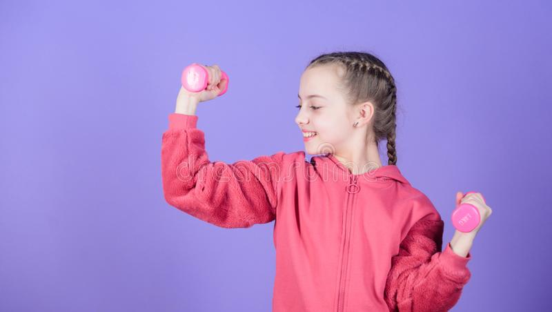 Workout of small girl hold dumbbell. Fitness diet for energy health. weight lifting for muscule. Childhood activity. Sport success. Happy child sportsman with royalty free stock images