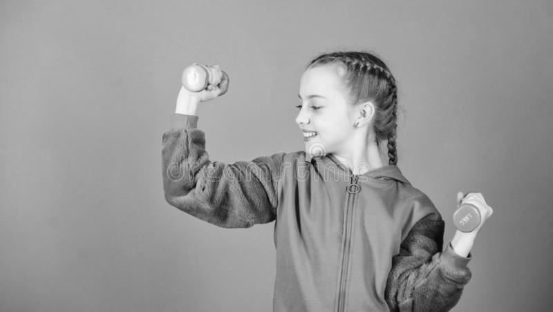 Workout of small girl hold dumbbell. Fitness diet for energy health. weight lifting for muscule. Childhood activity. Sport success. Happy child sportsman with stock images