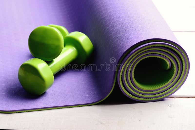 Workout and sport concept. Dumbbells made of green plastic stock photos