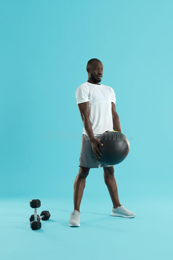 Workout. Sports man exercising with med ball, training stock image