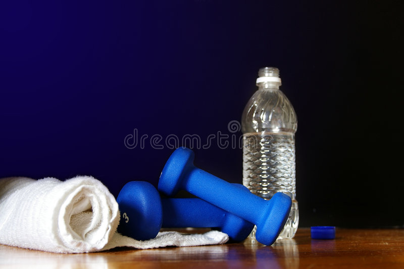 Workout stuff. Workout equipment ( water bottle, weights and towell stock photography