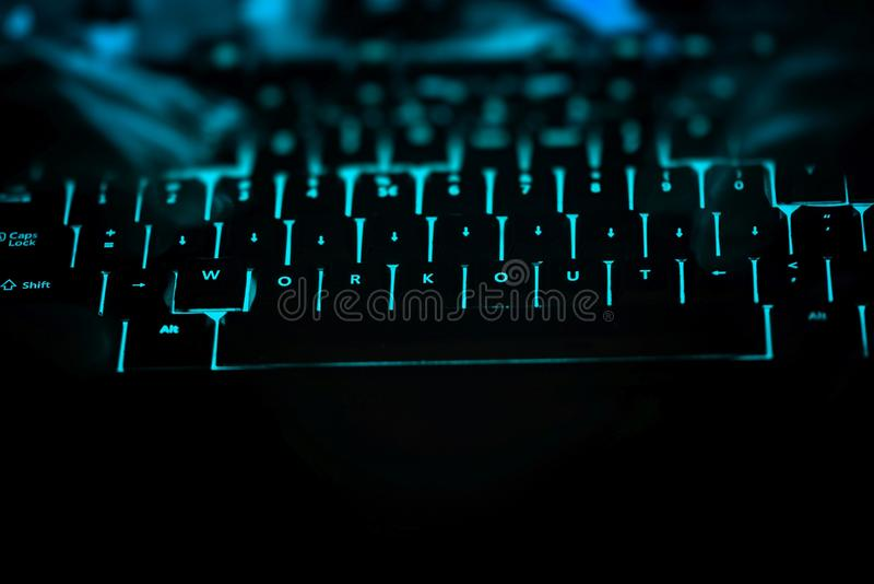 Workout - text on illuminated computer keyboard at night. Internet search concept royalty free stock photography