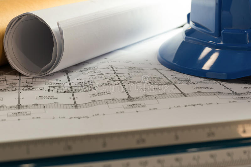 Workplace of architect - Architect rolls and plans.architectural plan,technical project drawing. Engineering tools view from stock photography