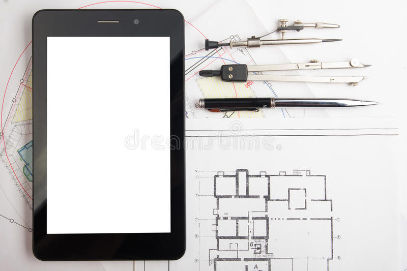 Workplace of architect - Architectural project, blueprints, rolls and tablet, pen, divider compass on plans. Engineering royalty free stock photo