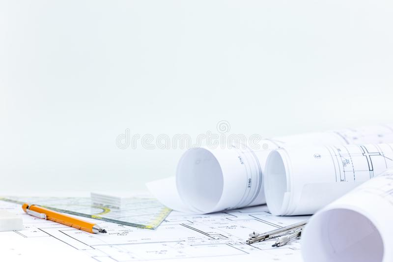 Architectural blueprint rolls and plans with drawing tools on de. Workplace of architect. blueprint rolls and plans with drawing tools on desk royalty free stock images