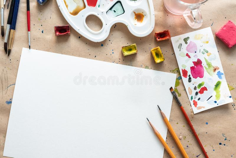 Workplace of an artist-painter on the paper cover stock photos