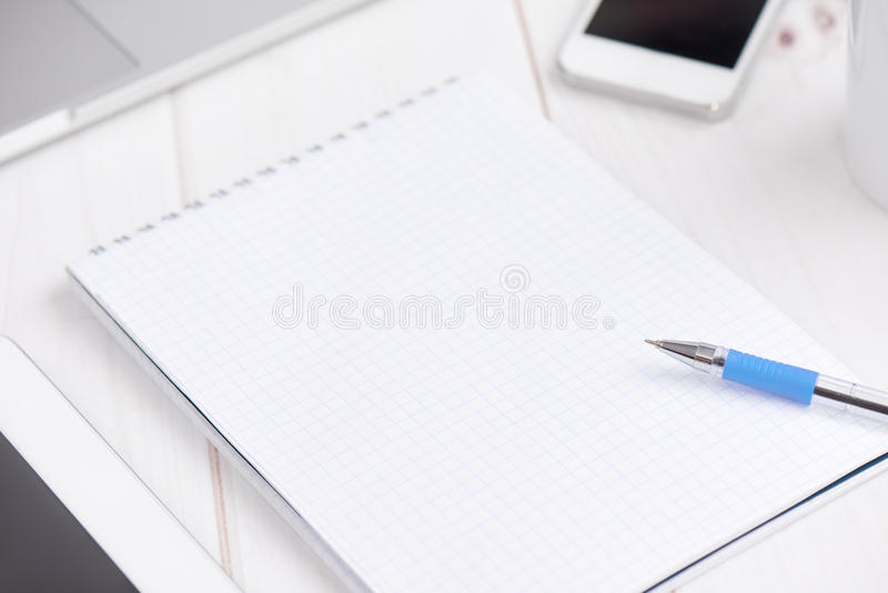 Workplace business. blank empty notebook, laptop, tablet pc, mob. Workplace business still life. blank empty notebook, laptop, tablet pc, mobile phone, pen royalty free stock photos