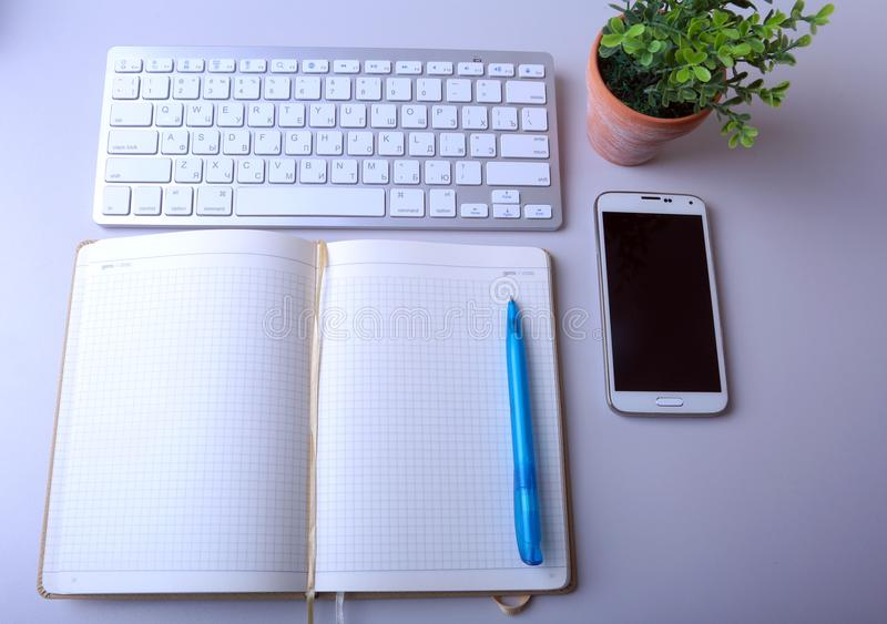 Workplace business still life. blank empty notebook, laptop tablet pc mobile phone, pen stock image