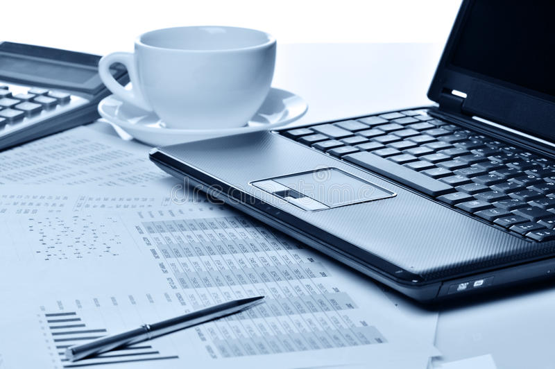 Workplace of the businessman. Laptop in an environment of financial calculations stock images
