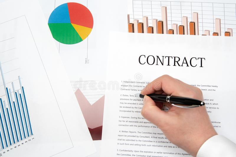 Workplace businessman. Contracts, charts, and graphs on the desk royalty free stock photos