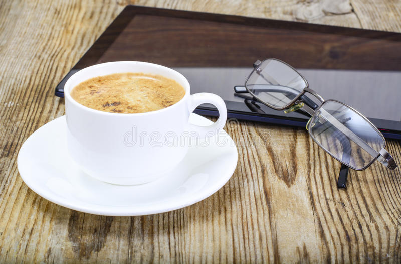 Workplace businessman: laptop, coffee and sunglasses. Workplace businessman: laptop coffee and sunglasses stock images