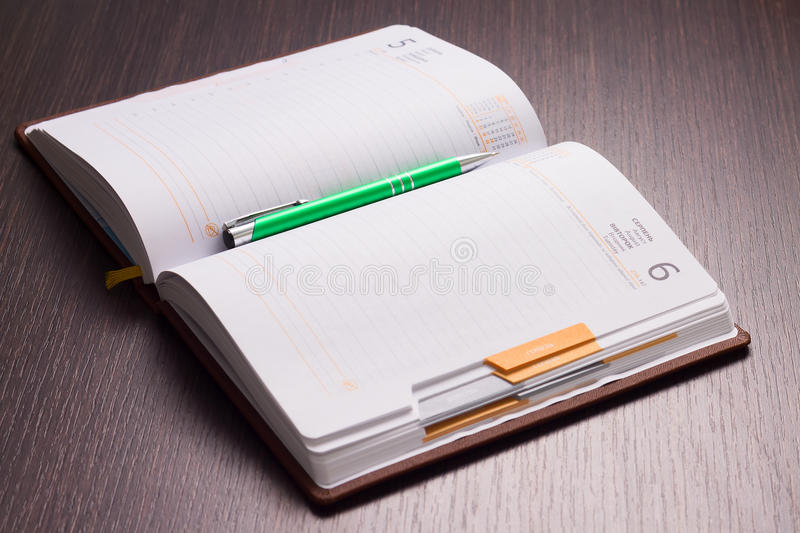Workplace of businessman. With opened diary and pen royalty free stock photos