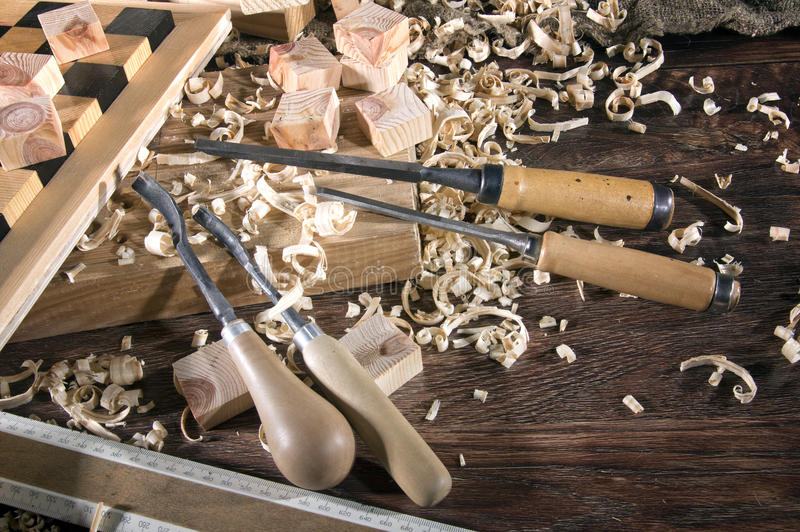 Workplace carpenter. Wood and a few tools stock photography