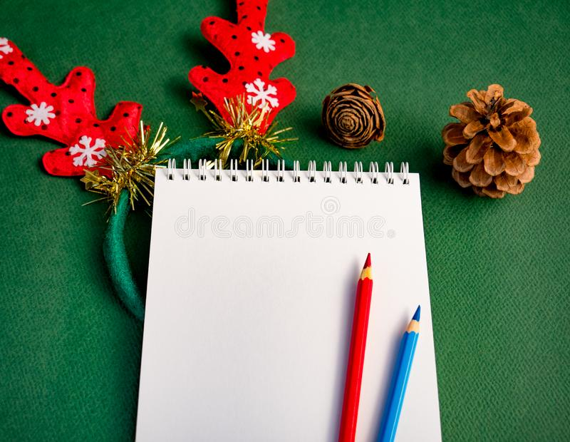 Workplace for Christmas concept. Blank notebook and colored pencils for your text stock photography