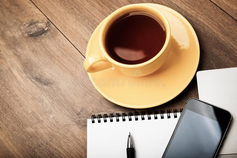 Workplace with cup of tea royalty free stock photography